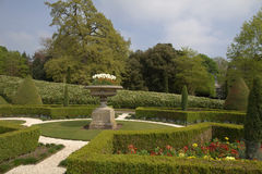 Spring garden at a Stately Home. Formal garden with topiary in Tatton Park Stock Photos