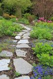 Spring garden walkway. Beautiful paved stone walkway in a spring garden Royalty Free Stock Photos
