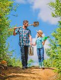Spring gardening checklist. It is time to plant prepare beds and care for lawn. Pick out flats favorite plants. Gardening pro tips. Spring gardening. Father royalty free stock photo