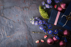 Spring gift with candy and flowers on a blue stone background Stock Photo