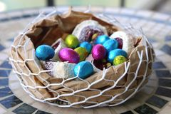 Happy Easter chocolate eggs a basket of sweets Royalty Free Stock Image