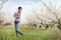 Spring girl. Pretty girl against blossoming trees Stock Image
