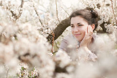 Spring girl. Pretty girl with blossoming trees Stock Image