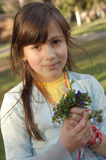 Spring girl. Adorable little girl with a bunch of spring flowers Royalty Free Stock Photography