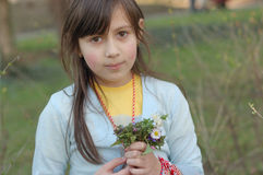 Spring girl. Adorable little girl with a bunch of spring flowers Royalty Free Stock Image