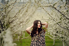 Spring girl.Beautiful model with flower wreath on her head.Close up portrait of romantic sensual brunette lady with blue eyes and Royalty Free Stock Photography
