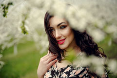 Spring girl.Beautiful model with flower wreath on her head.Close up portrait of romantic sensual brunette lady with blue eyes and Royalty Free Stock Photos