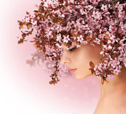 Spring Girl. Beautiful Woman with Cherry Blossom Stock Image