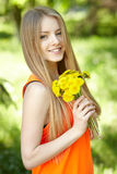 Spring girl with bunch of dandelions Stock Photography