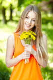 Spring girl with bunch of dandelions Royalty Free Stock Photo