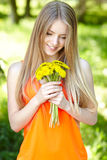 Spring girl with bunch of dandelions Royalty Free Stock Photos