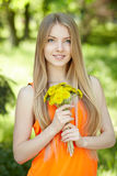 Spring girl with bunch of dandelions Stock Photos