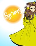 Spring girl in a fashionable yellow raincoat. Girl with flowers in her hair Stock Images