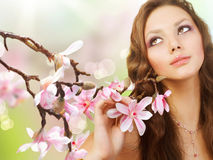 Spring Girl with Flowers. Beautiful Spring Girl with Magnolia Flowers Stock Photo