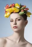 Spring girl with garland. Beauty close-up portrait of cute girl with floral garland on her head, cute make-up and perfect skin. Spring concept Royalty Free Stock Photography