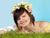 Spring girl in grass Stock Image