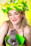 Spring girl holding a bunny stock photos