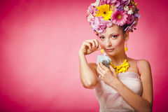 Spring girl with jewelry gift box and flowers hair Royalty Free Stock Photo