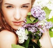 Spring girl with  lilac flowers. Royalty Free Stock Images