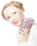 Spring girl with  lilac flowers. Royalty Free Stock Photography