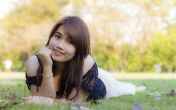 Spring Girl lying on the Field Stock Image