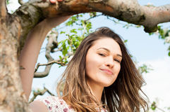 Spring girl outdoor portrait in blooming apple trees Royalty Free Stock Photography