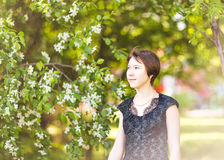 Spring  girl outdoor portrait in blooming trees. Beauty Romantic woman in flowers. Sensual Lady. Beautiful Woman Royalty Free Stock Photos
