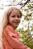 Spring girl portrait. Portrait of little pretty girl with blonde hair on spring background Stock Photo