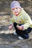 Girl draws on the ground rod Stock Photo