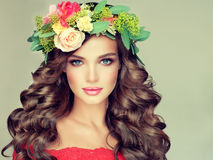 Spring girl. Wreath on the head. Beautiful woman model brunette with long curly hair and floral wreath on the head. Spring girl Stock Photos