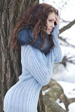 Spring grace. Portrait of beautiful woman in a winter forest Stock Photography