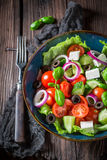 Spring Greek salad with feta cheese, black olives and lettuce Stock Photo