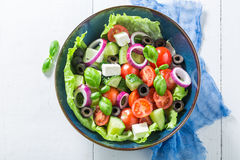 Spring Greek salad with lettuce, cherry tomatoes and feta cheese Stock Images