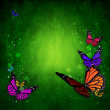 Spring green background with colorful butterflies Royalty Free Stock Photography