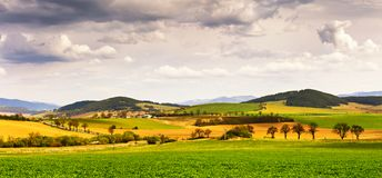 Spring green field and meadows on the hills panorama Royalty Free Stock Image