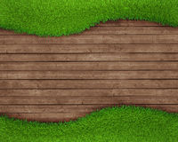 Spring green grass over wood background Royalty Free Stock Photography