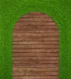 Spring green grass over wood background Royalty Free Stock Photos