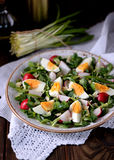 Spring green salad from organic radish, wild garlic with boiled eggs, olive oil and parmesan. royalty free stock photo