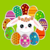 Spring greeting background with Easter eggs and a cute bunny. Spring greeting background with Easter eggs and a cute little white bunny. Festive paper images of Stock Photography