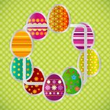 Spring greeting background with Easter eggs. Festive paper image. S of eggs on a square light frame. Country style green tablecloth. Vector greetings card with Stock Photos