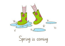 Spring greeting card with rubber boots Stock Photography