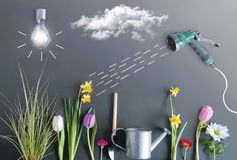 Spring growth concept. Spring flower bed garden with clouds, light bulb as the sun, and hose pipe with a sketch of water being sprayed Royalty Free Stock Photo