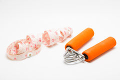Spring Hand Grip Strengthener and Exerciser and ta Stock Image