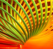 Multicolor toy background. Plastic spring toy in rainboy colors Royalty Free Stock Images