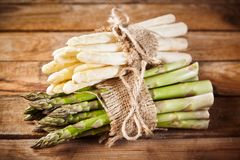 Spring harvest of fresh green and white asparagus Stock Photo