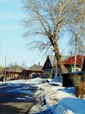 Spring in the village. Spring has come to the village street of Altai Stock Image