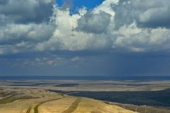 Spring heath. This is somber clouds in Caucasus heath in spring Royalty Free Stock Photo