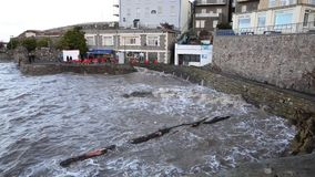 Spring high tide brought high waves and even a tree to Madeira Cove Weston-super-Mare on Saturday 21st February 2015 stock footage