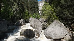 Spring high water levels on vernal falls in Yosemite national park. As seen from the bridge over the Merced river stock footage