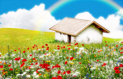 Spring in the hills. Spring scene with little house in the hill, garden, blue sky and rainbow Royalty Free Stock Photography